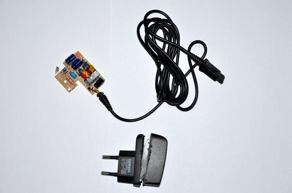 Разобранное зарядное устройство для телефона